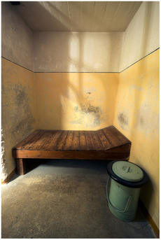 Inside a dark cell, single confinement.