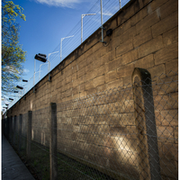 Outside the prison wall, Genslerstrasse, entrance at the far end.